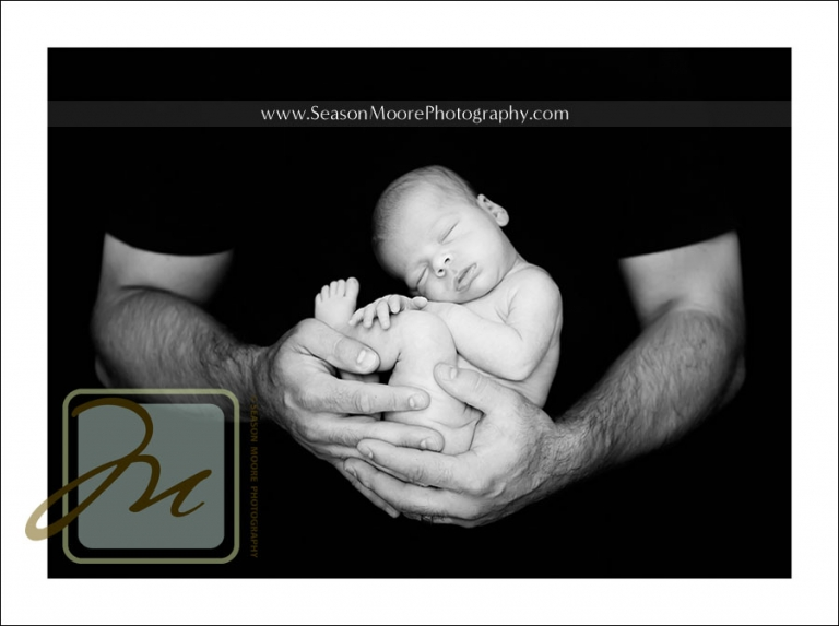 newborn-in-dads-hands