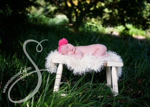 newborn girl outside under tree