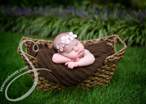 newborn girl outside basket