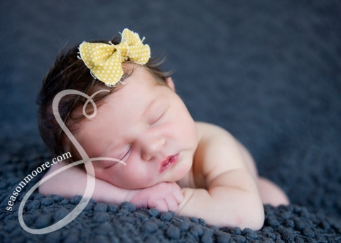 newborn with yellow bow