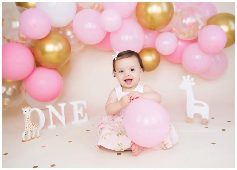 sophie giraffe cake smash baby girl pink gold balloon garland